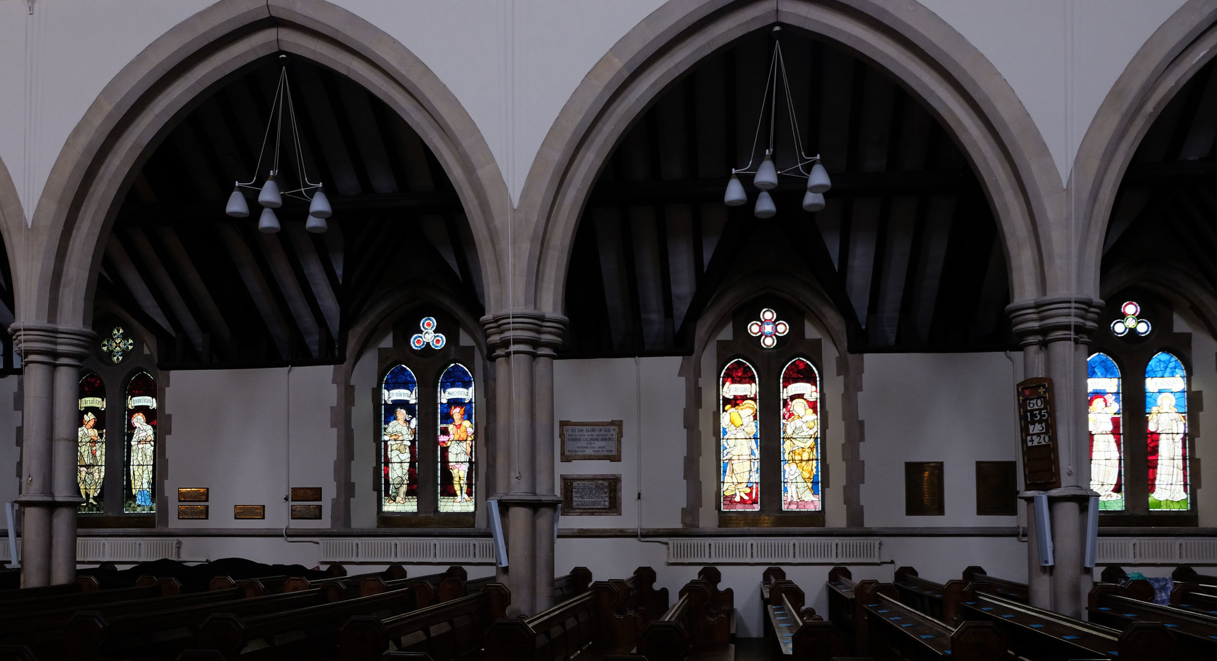 North Aisle, left to right: Liberalitas & Humanitas (1899), Prudentia & Justitia (1885), Temperentia & Caritas (1876), Spes & Fides (1876)