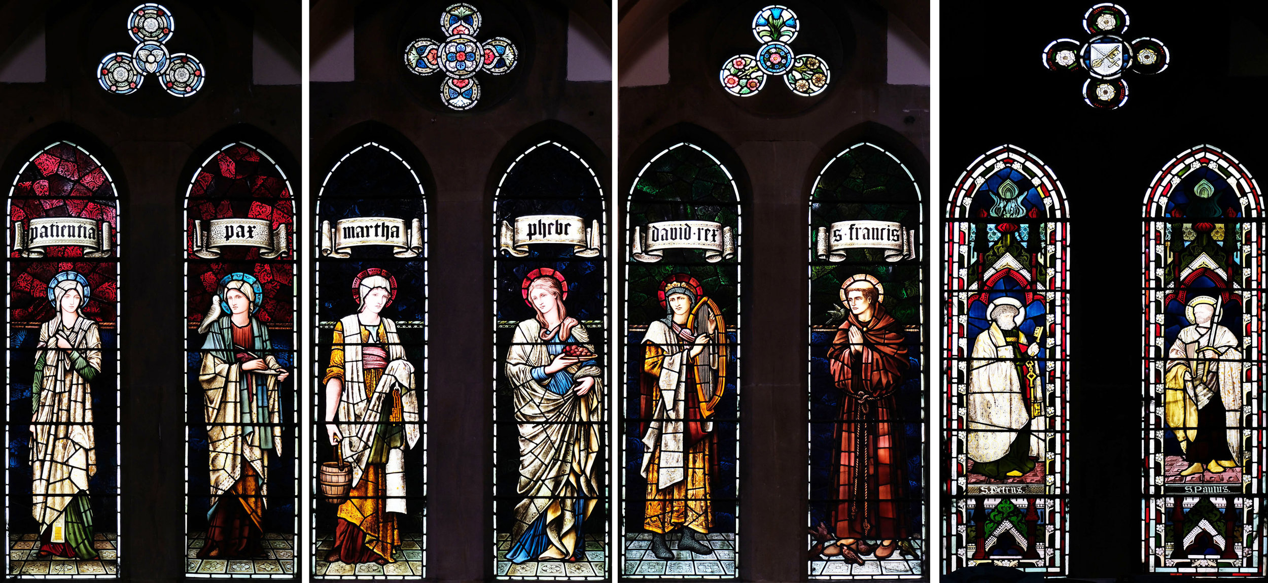 South Aisle, left to right: Patientia & Pax (1909), Martha & Phebe (1903), King David & St Francis (1911), St Peter & St Paul (1865).