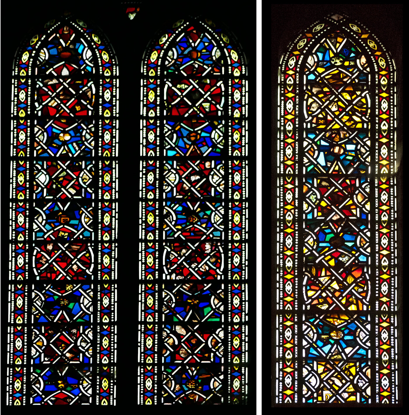 High up windows, mostly red and blue, one with more yellow glass