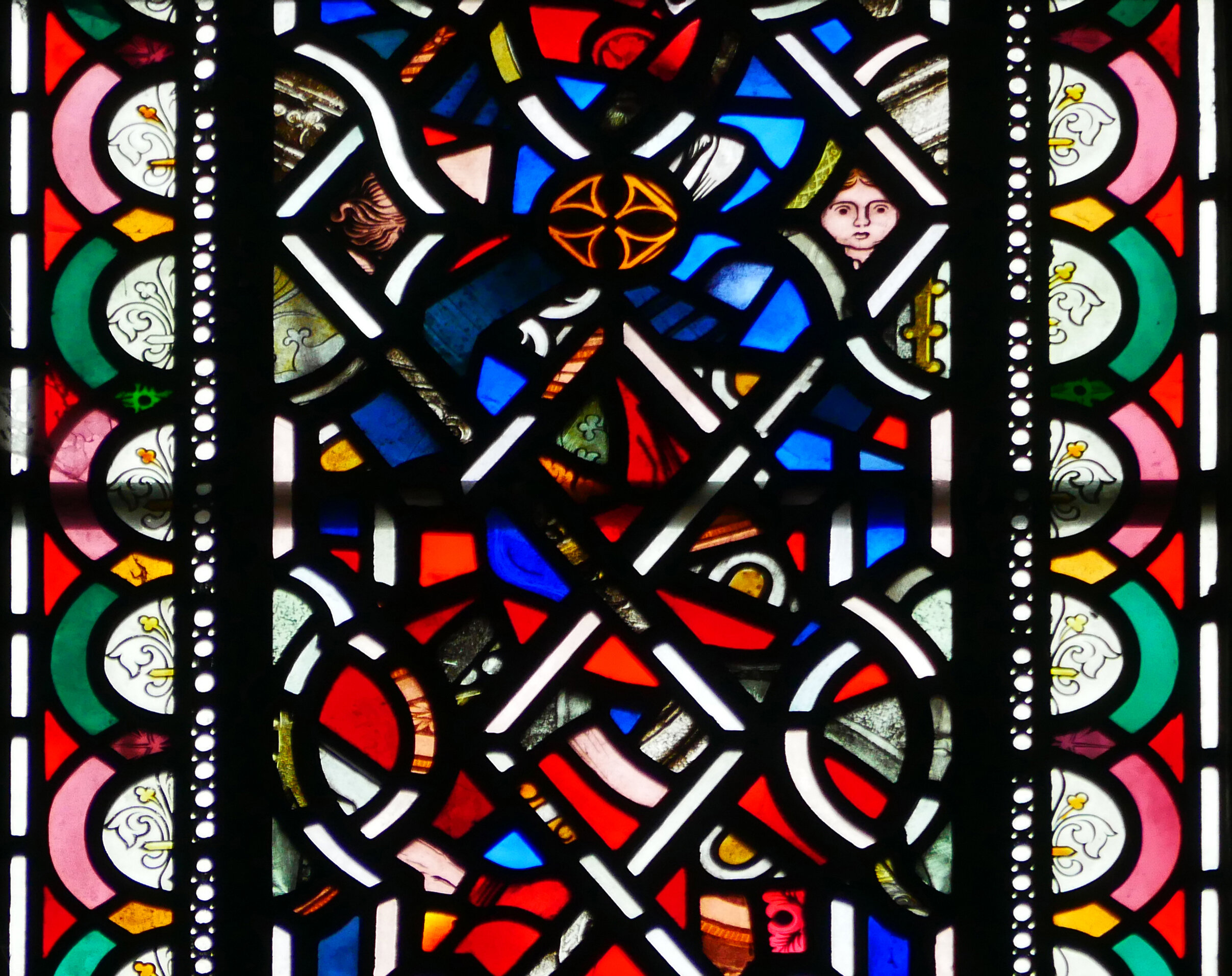Detail from a window high up in the east end of the church