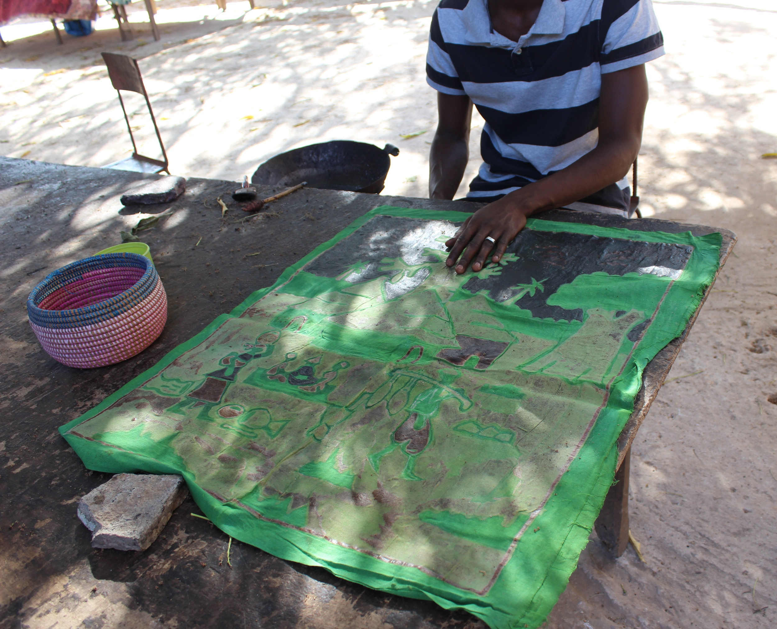 The Batik Factory in Serrekunda is a family business. Batik in process - applying a layer of wax to the cloth.