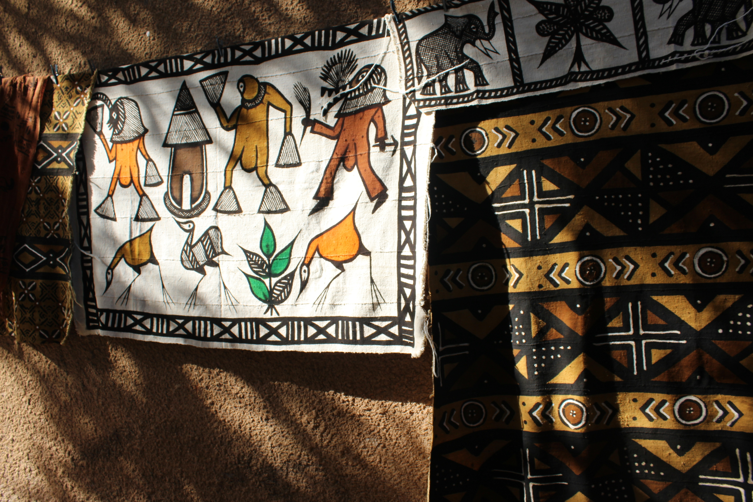 Mud cloth drying in the sun. These might be used as Wall hangings or rugs or for heavier clothing.