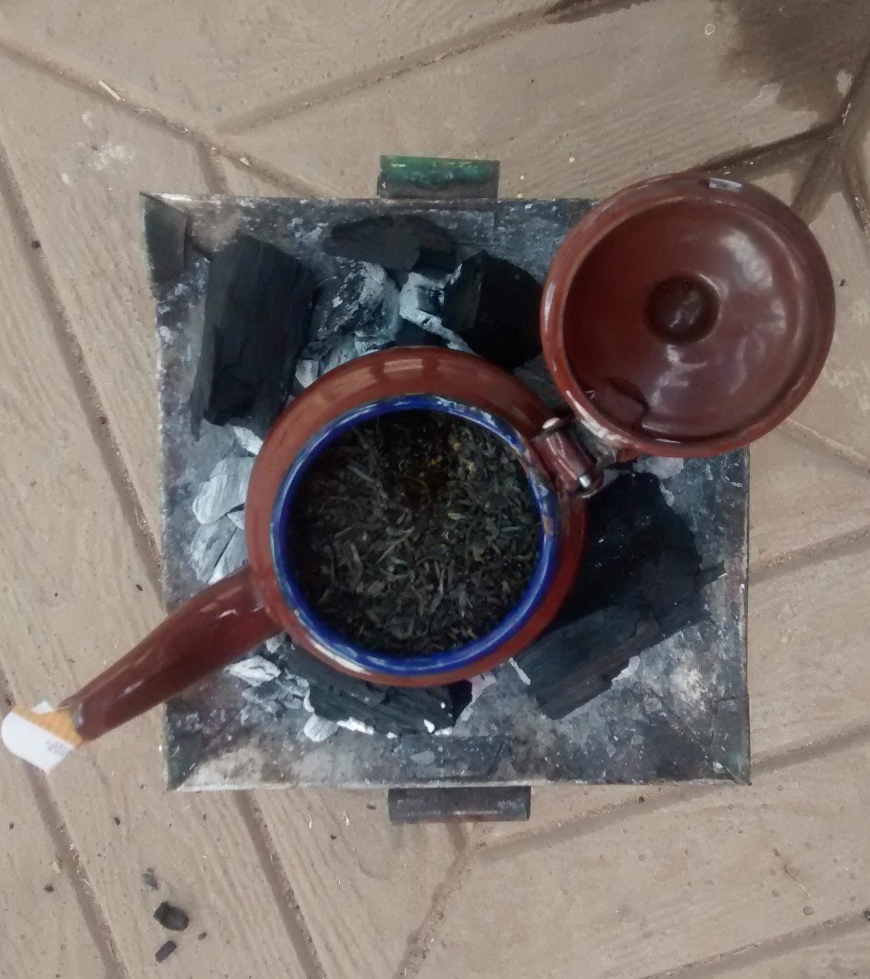Green tea brewing in progress. 1st cass (glass) of three. This stuff is strong and addictive, bitter yet delicious.