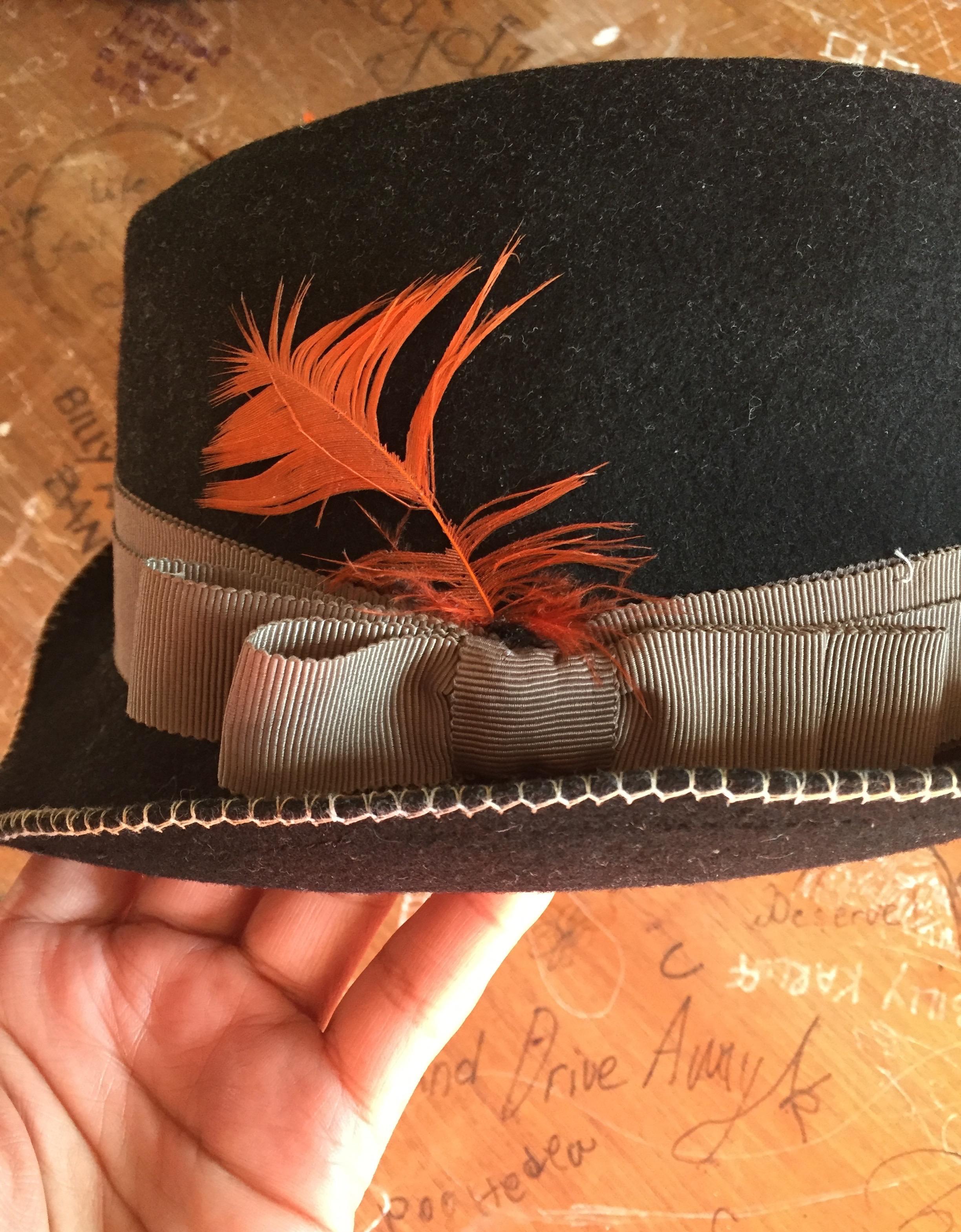 The original orange feather remains.