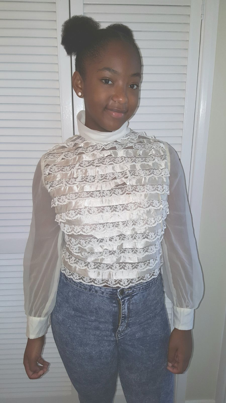 Alisons teenage daughter, Jaya,wearing her grandmothers vintage lace blouse.