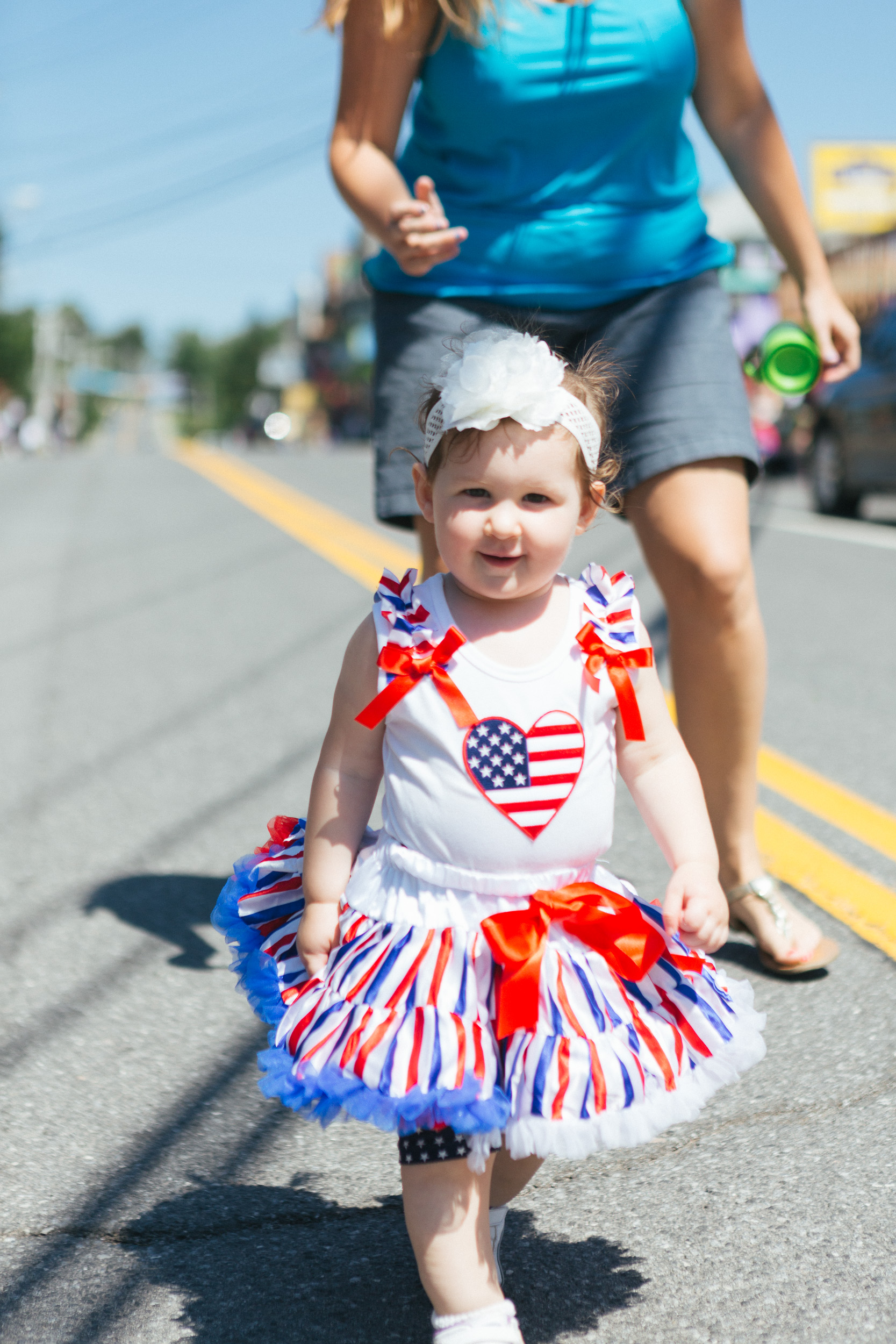 A girl in a patriotic dress walks down Main Street in Tannersville.jpg