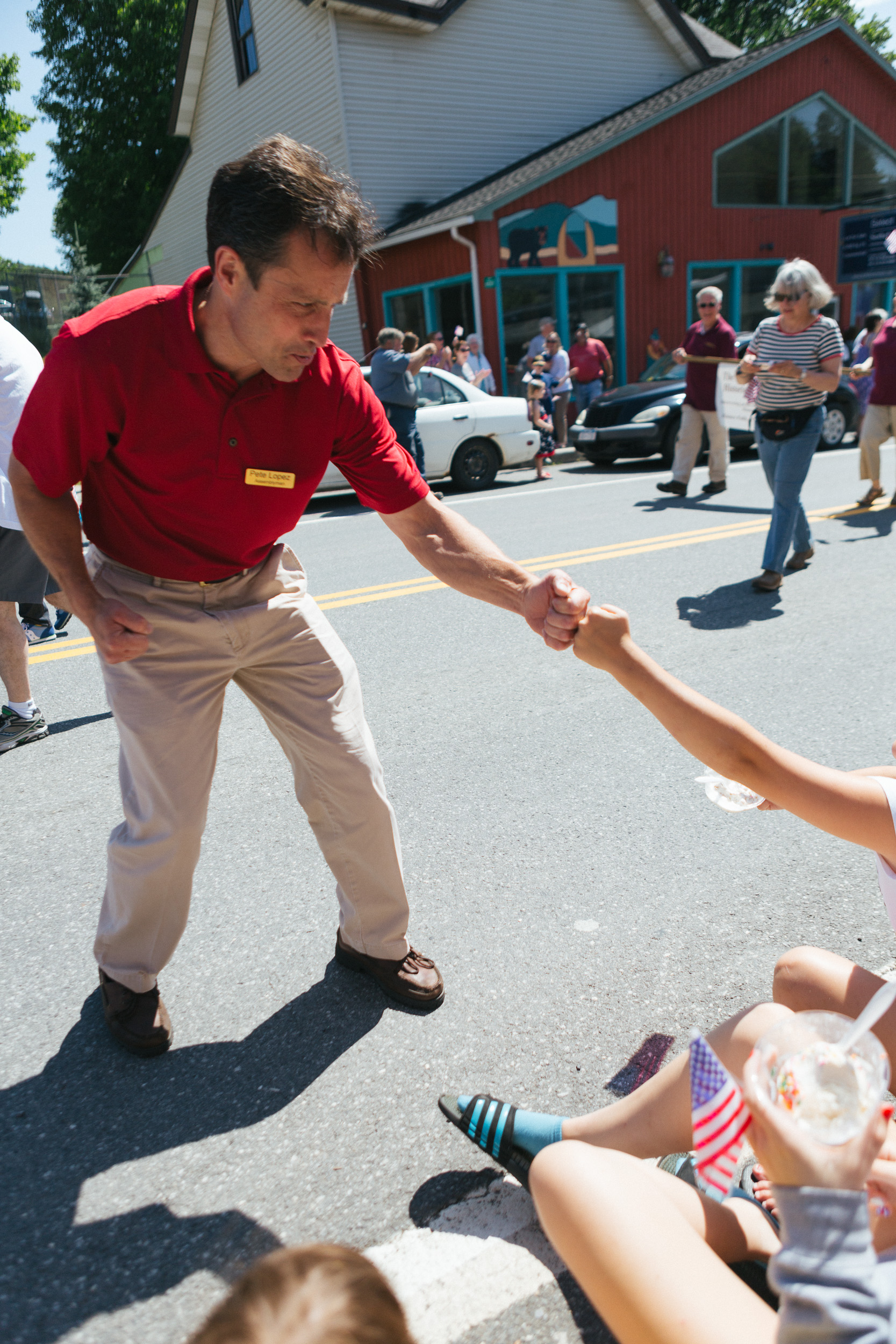 A politician greets children with a fist bump at the Tannersville Parade.jpg