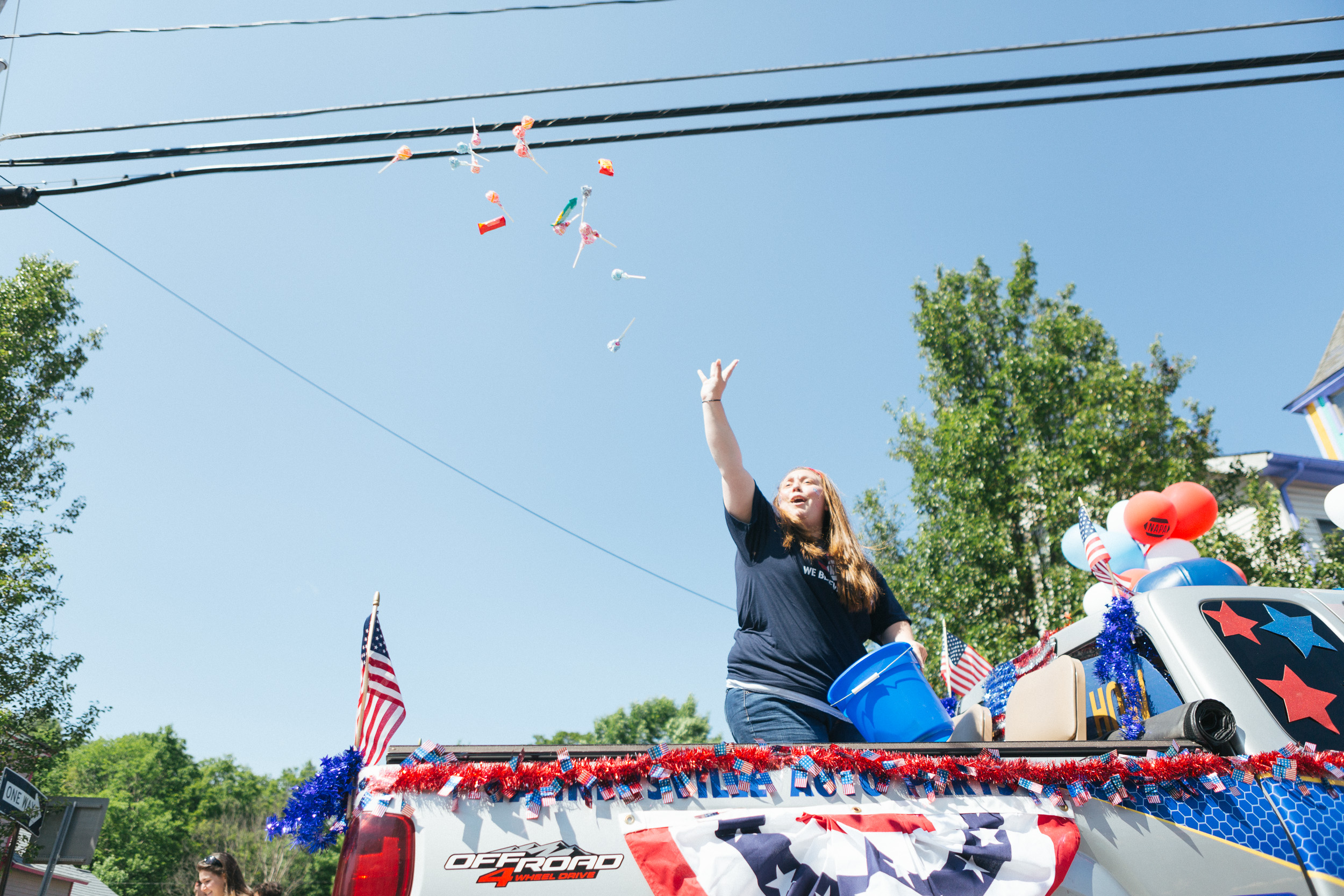 A woman launches candy into the air during the Tannersville Parade.jpg