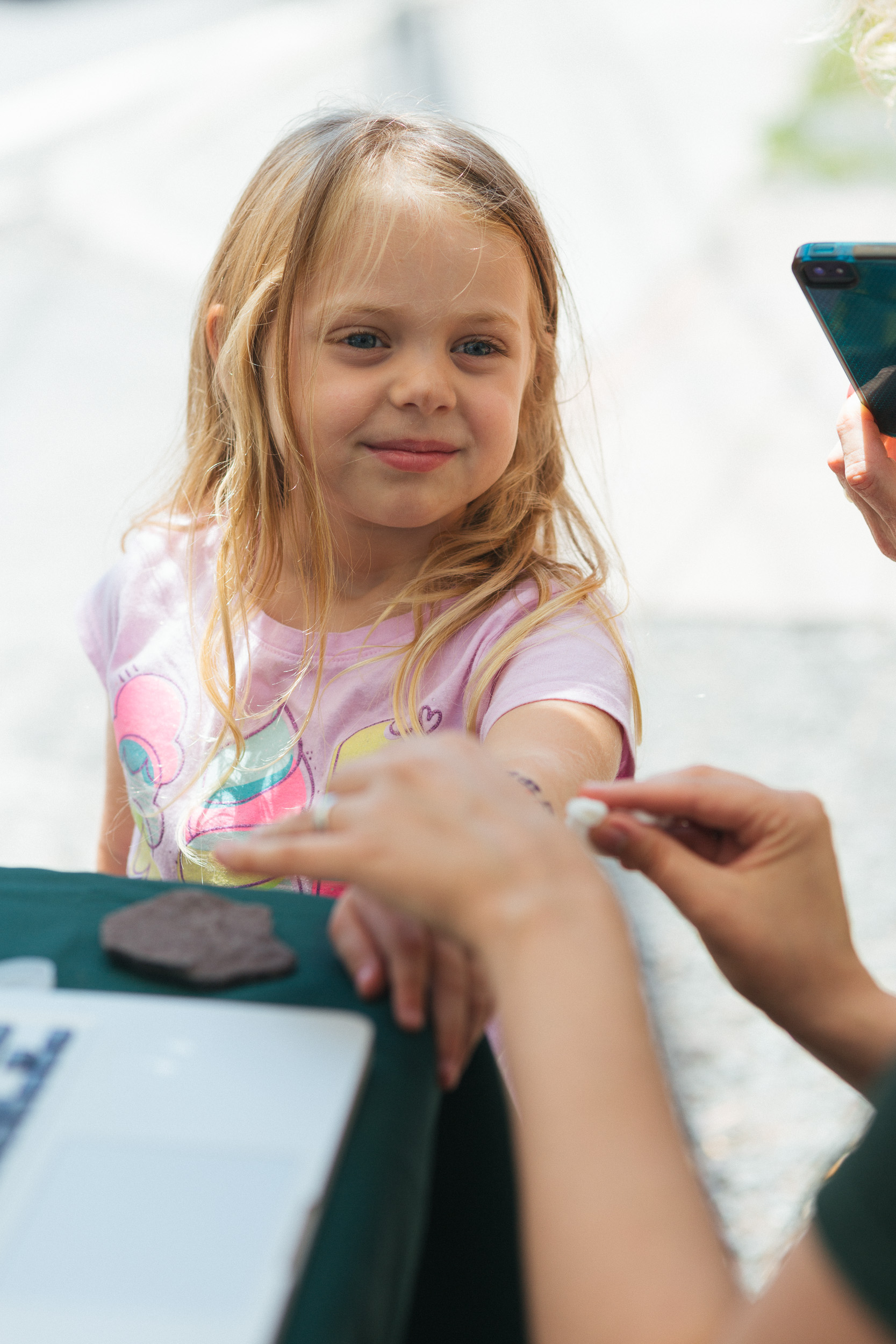 Ava gets a temporary tattoo at the 23Ai booth on Main Street in Tannersville .jpg