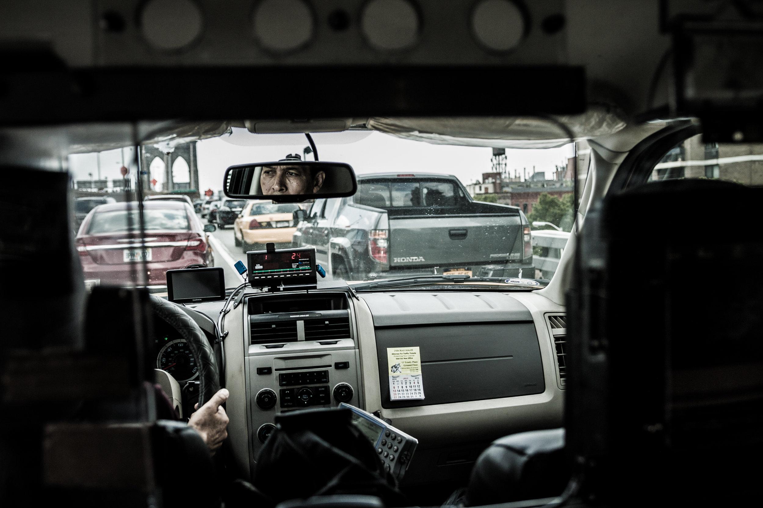 NYC-TaxiDriverBKBridgeRearview-73114-1.jpg
