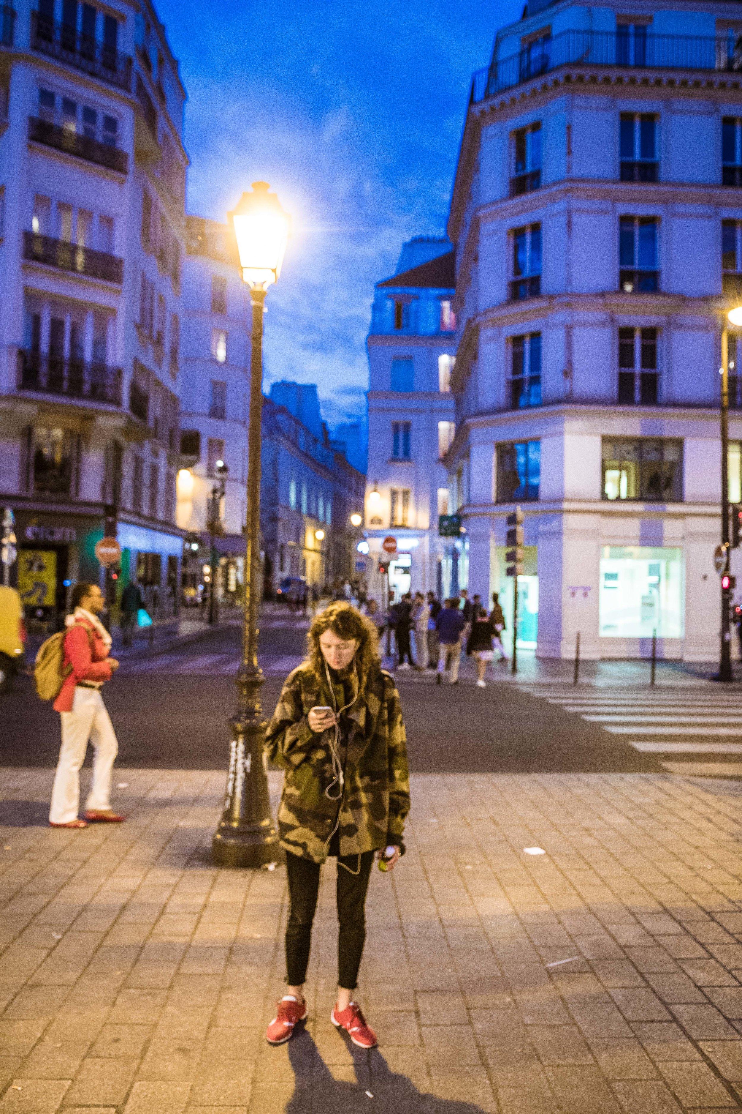 Fra-Paris-CheckingPhoneStPaulMetro-1.jpg