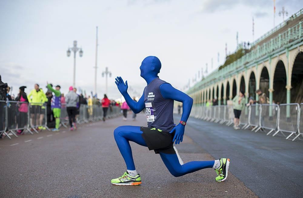 Matt Phillips, aka Running Morph, warms up before the Vitality Brighton Half Marathon held on Sunday 22nd February 2015.Photo credit : Chris Winter