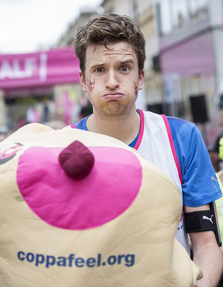 BBC Radio 1 DJ Greg James (with his Coppafeel charity boob) finishing the Vitality Bath Half Marathon. 1st March 2015.Photo credit : Chris Winter