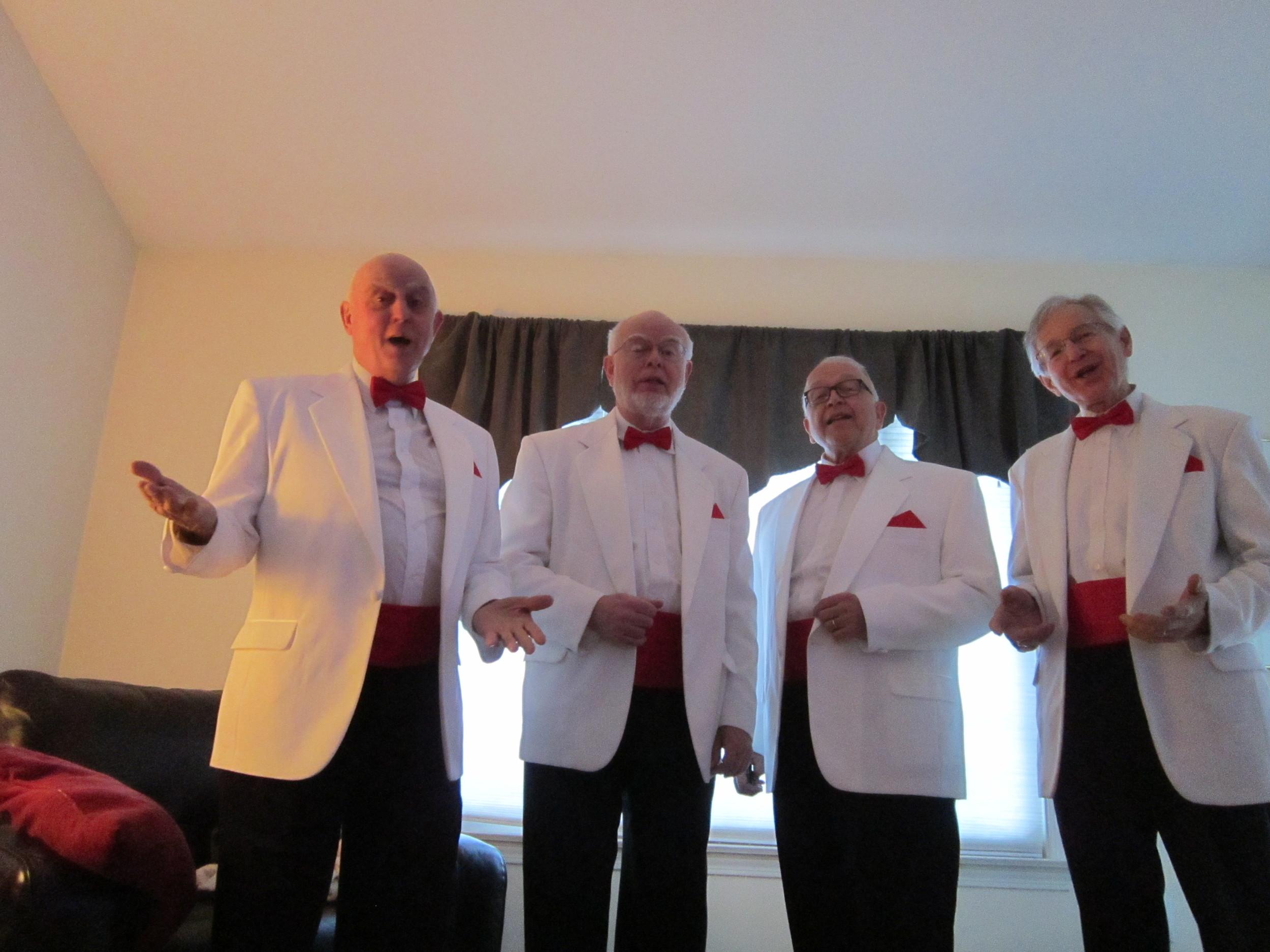 Quartet sings to Susan Coogan 2.JPG