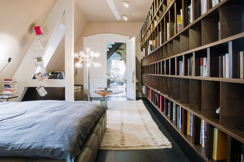 The bedroom with a big library of books. The door leads into the living room. Peter Ippolito's and Stefan Gabel's home in Stuttgart.    