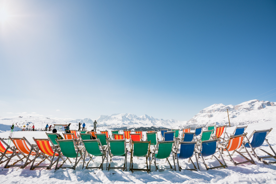 Folding chairs in front of Rifugio Bioch where skiiers can sip their wine and enjoy the views.