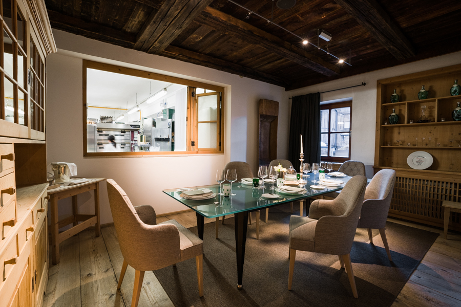 Chef's table at St. Hubertus restaurant with a view inside the big kitchen
