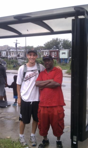 Teddy Krolik (left) with Reservoir Hill resident Randy Howell (right) on Whitelock Street.