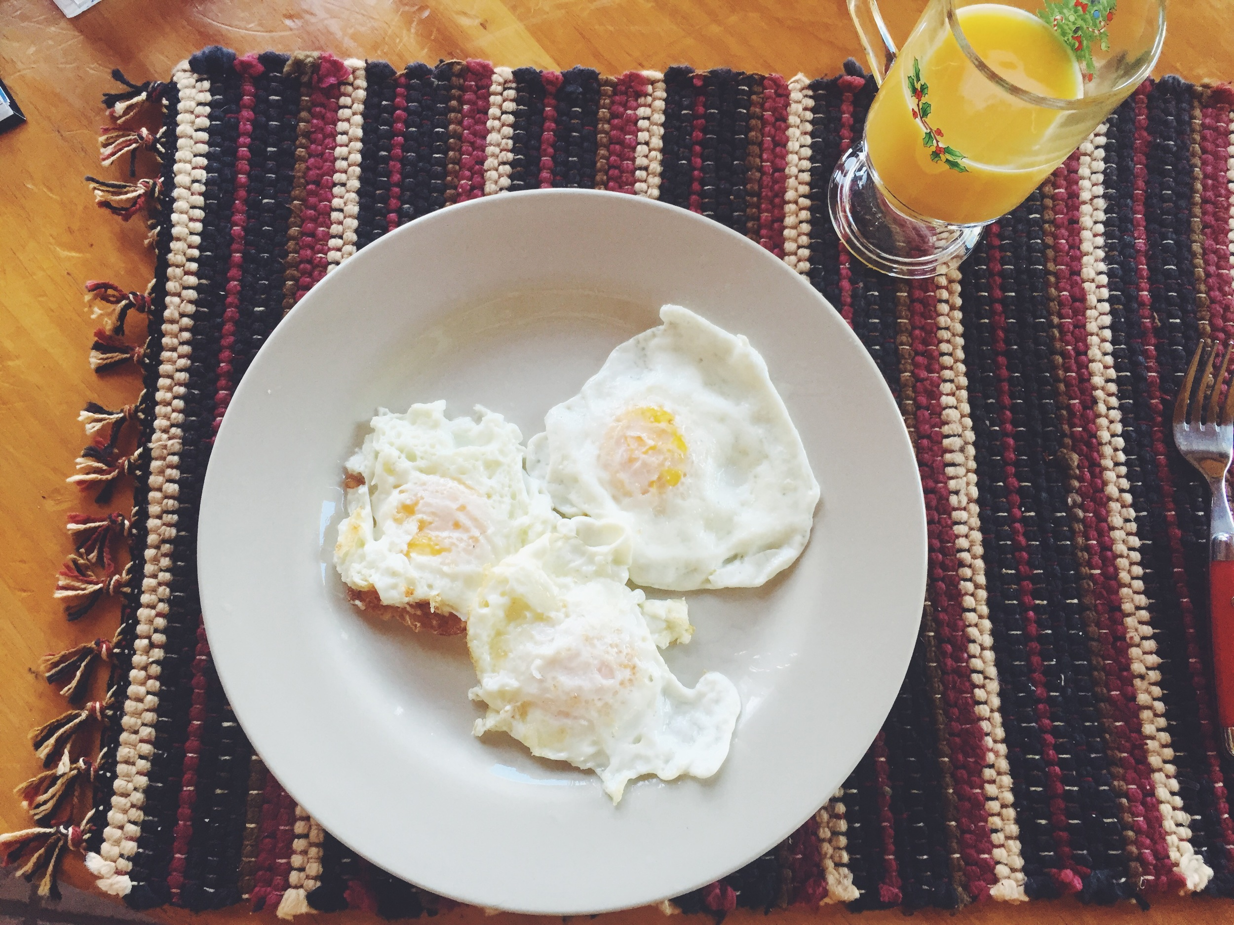 Working on perfecting my fried eggs...also its never too early for a Christmas glass