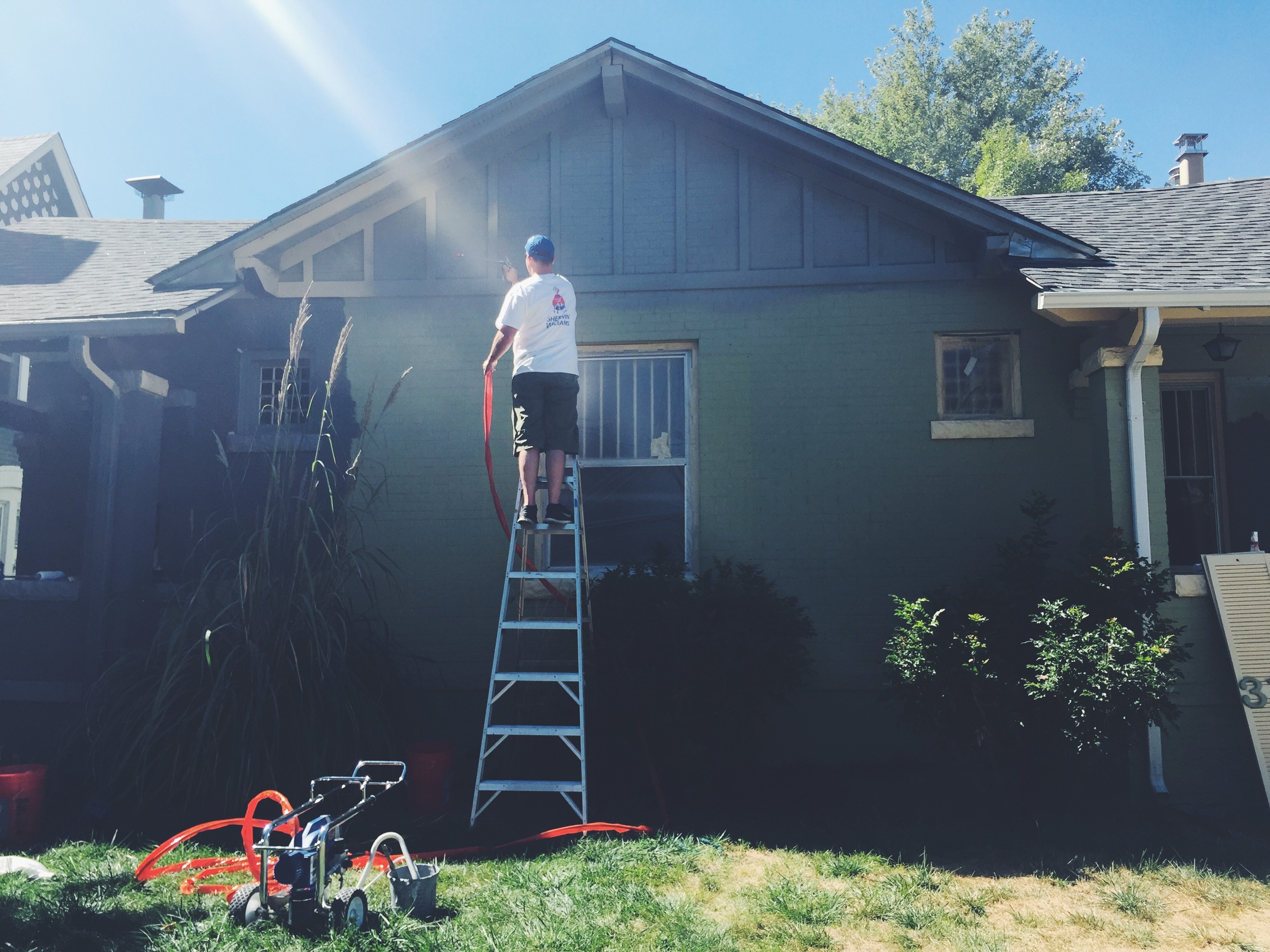 Our neighbor Rob - rented a sprayer and painted the front of the house in about 1 hour.