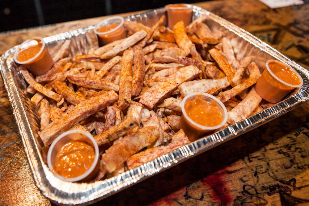 Taro Fries -  Fresh hand cut taro, seasoned w/ Haus spices, served w/ Haus sauce.