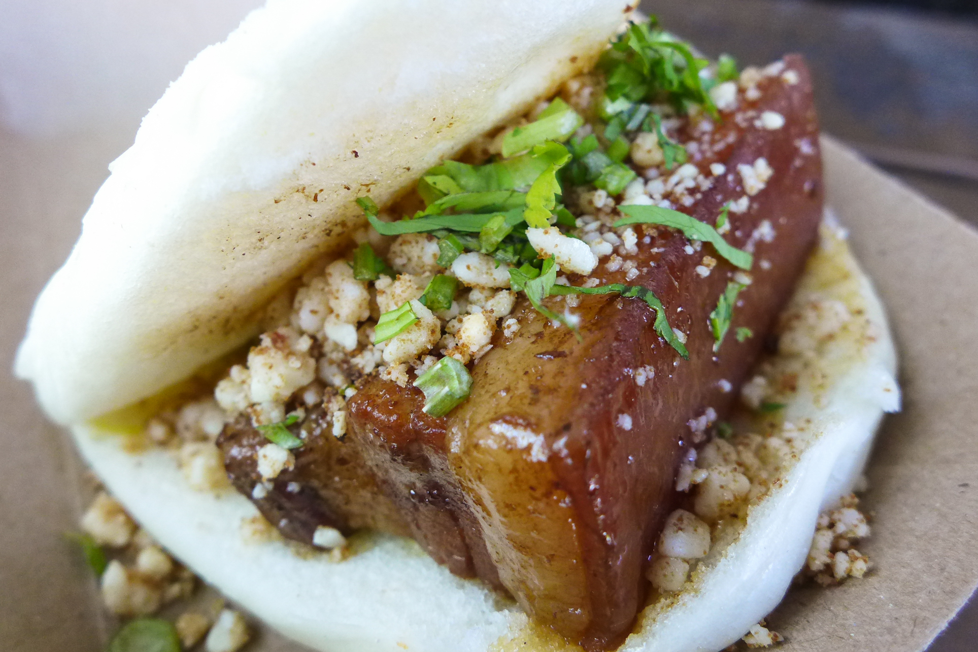Chairman Bao®  - $4.05  Braised all natural Berkshire pork belly served with Haus Relish, crushed peanuts, Taiwanese red sugar, and cilantro.