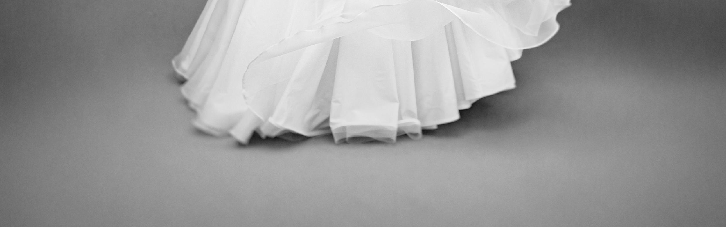 hem of ball gown skirt