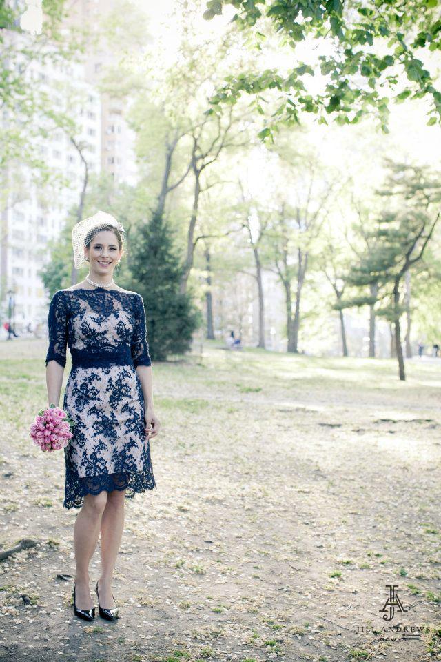 Bride in navy lace custom wedding dress