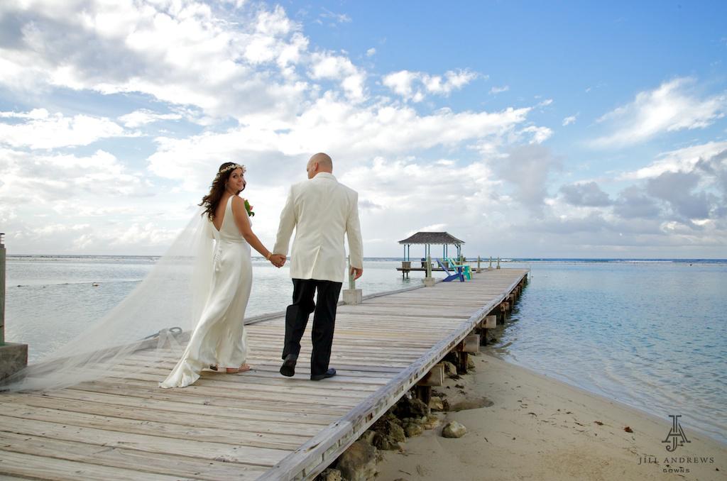 Beach bride in low back wedding dress