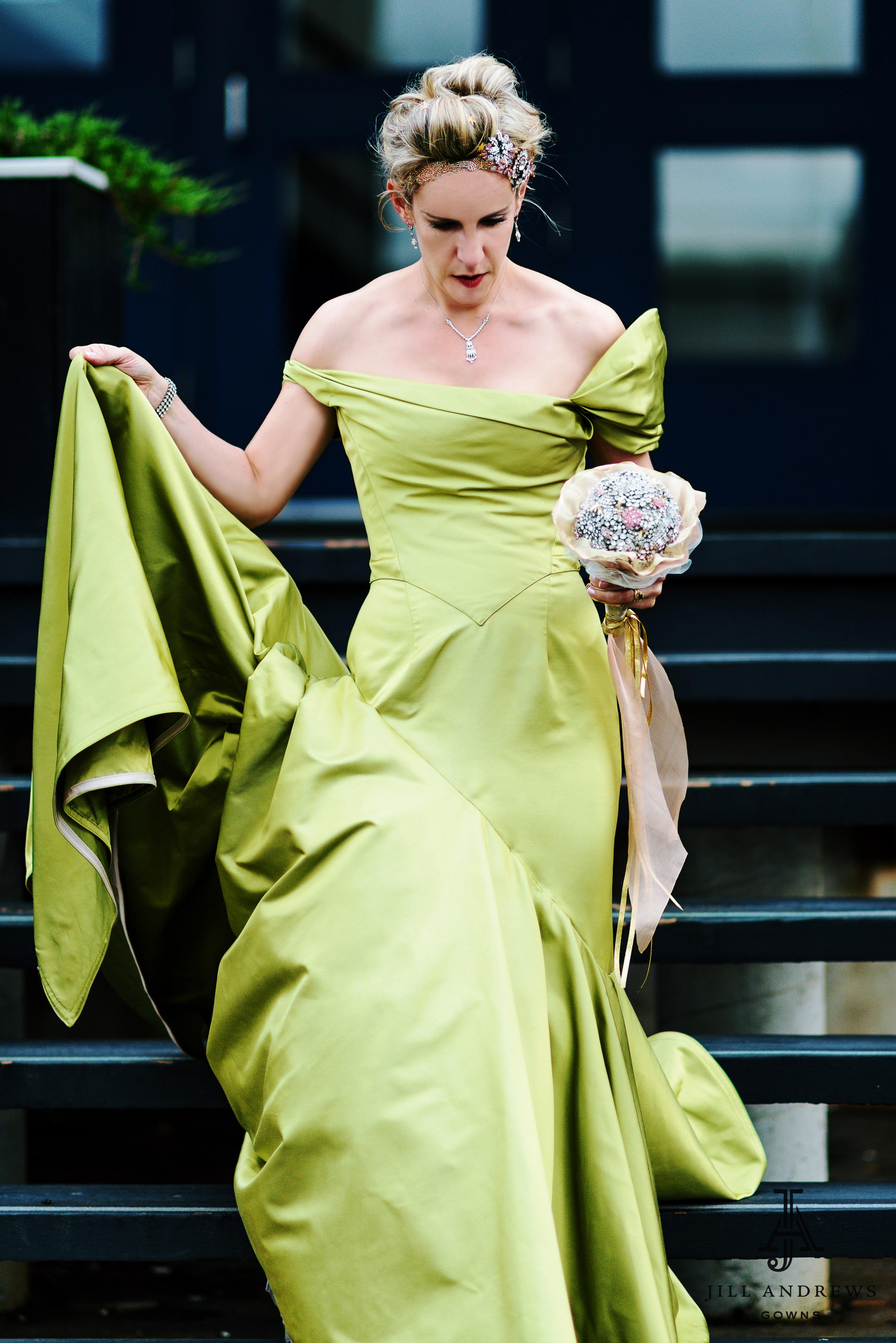 Bride in asymmetrical custom wedding dress