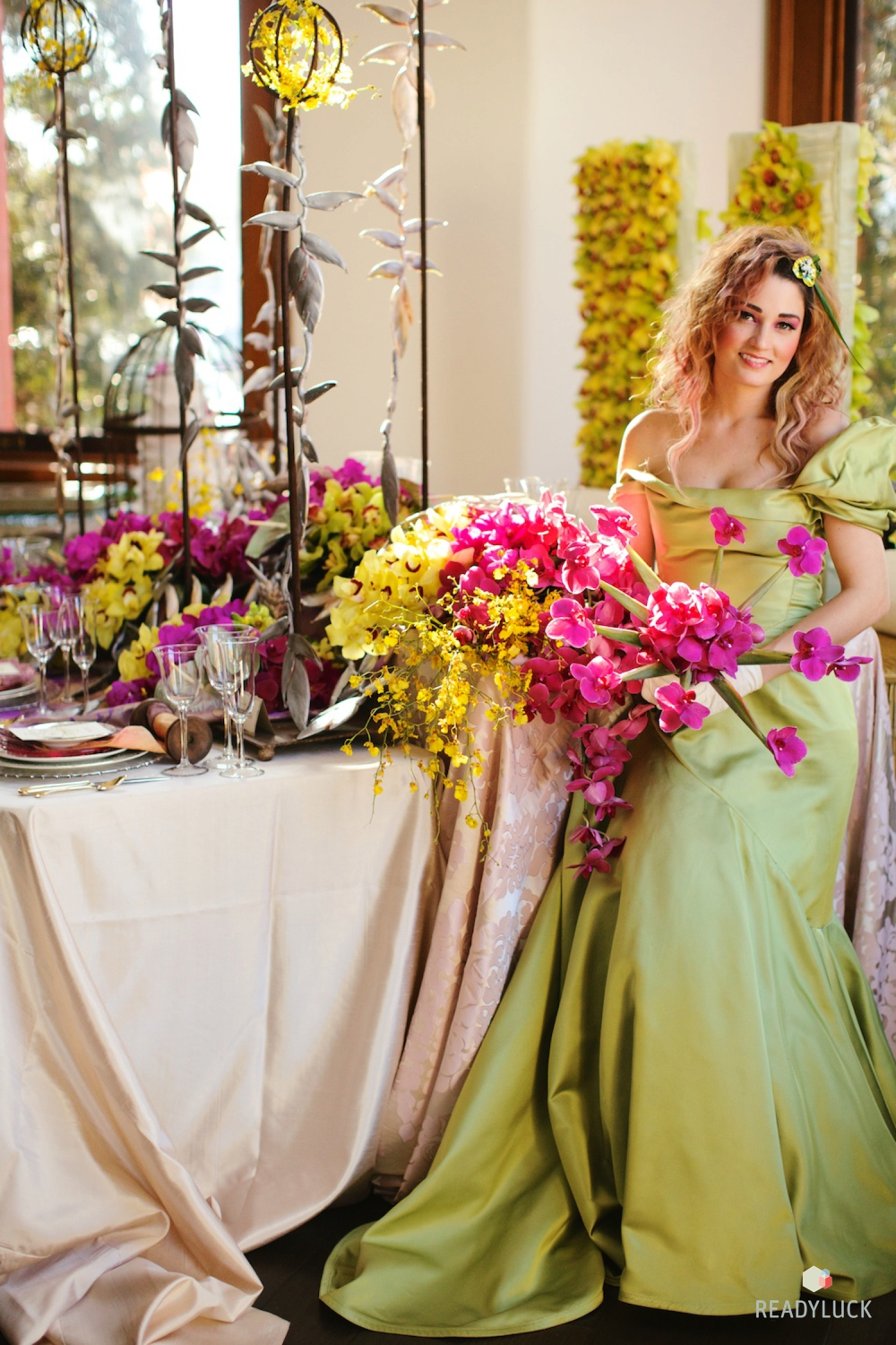 Bride in a custom gown holding pink bouquet
