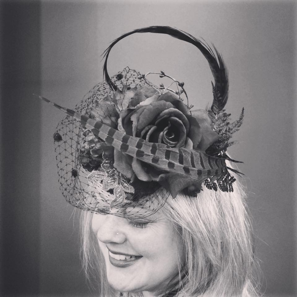 extravagant flower and feather fascinator