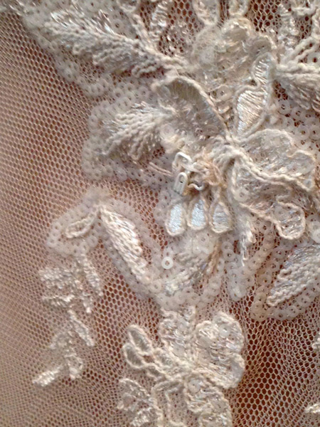 These hooks with which to attach Shannon's bustle were haphazardly sewn onto the lace of her gown. Jill removed and reattached them with care, so they were camouflaged in the fabric – invisible to the untrained eye.