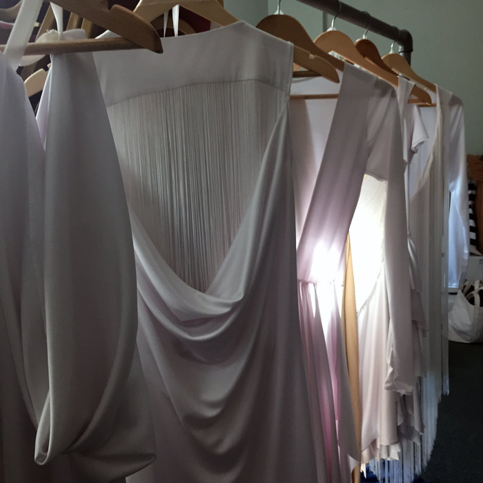 After a week of designing and bringing these dresses to life, it was so satisfying to see them all hung up together in our dressing room.