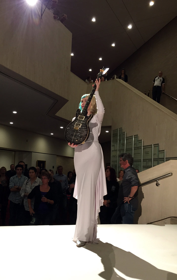 Sarah lifts a stunning guitar signed by Carlos Santana.