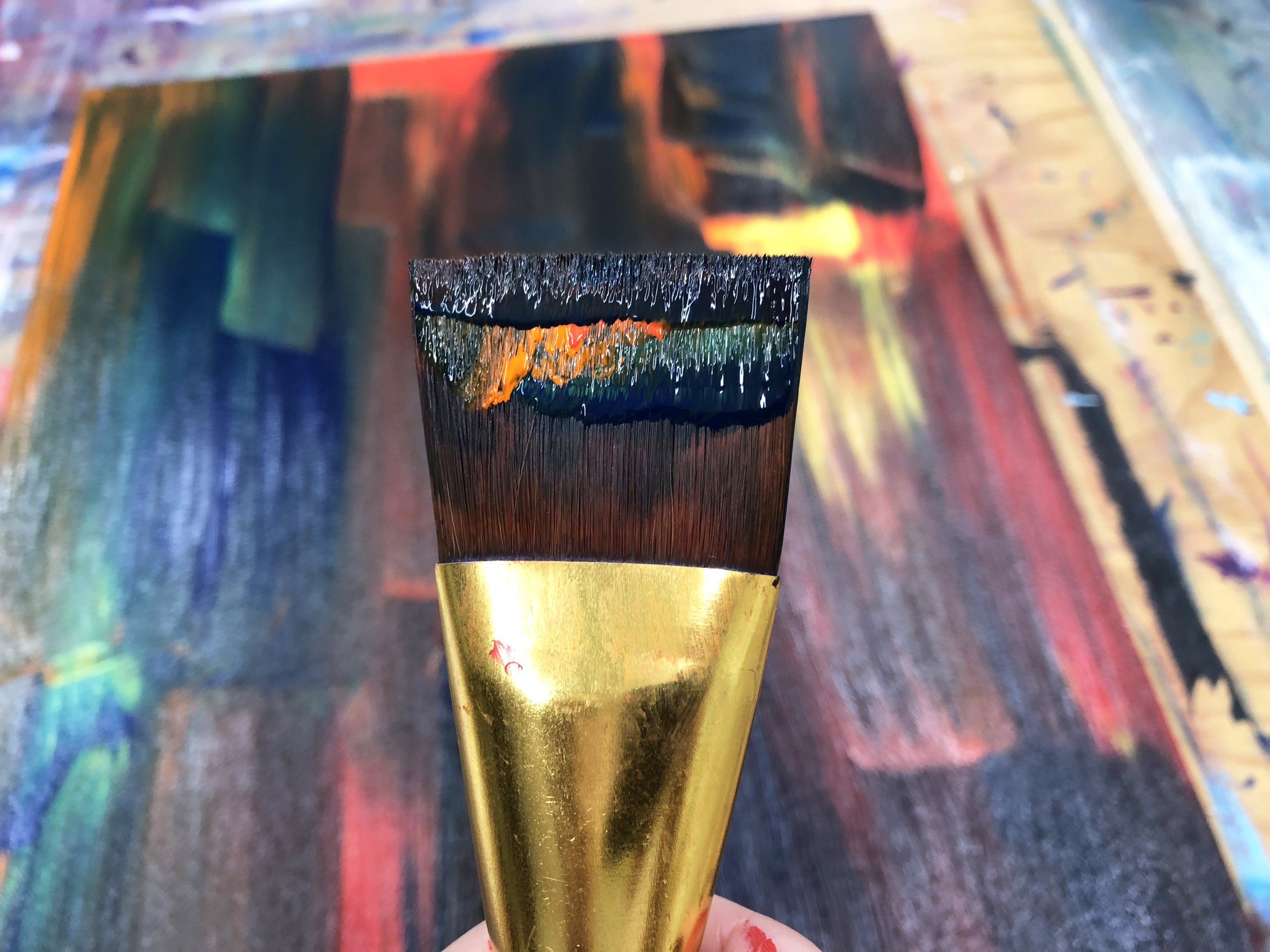 paint filled brush strokes in mixed media art