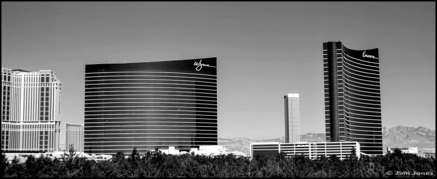 A black and white photograph of the Wynn Exclusives resort.
