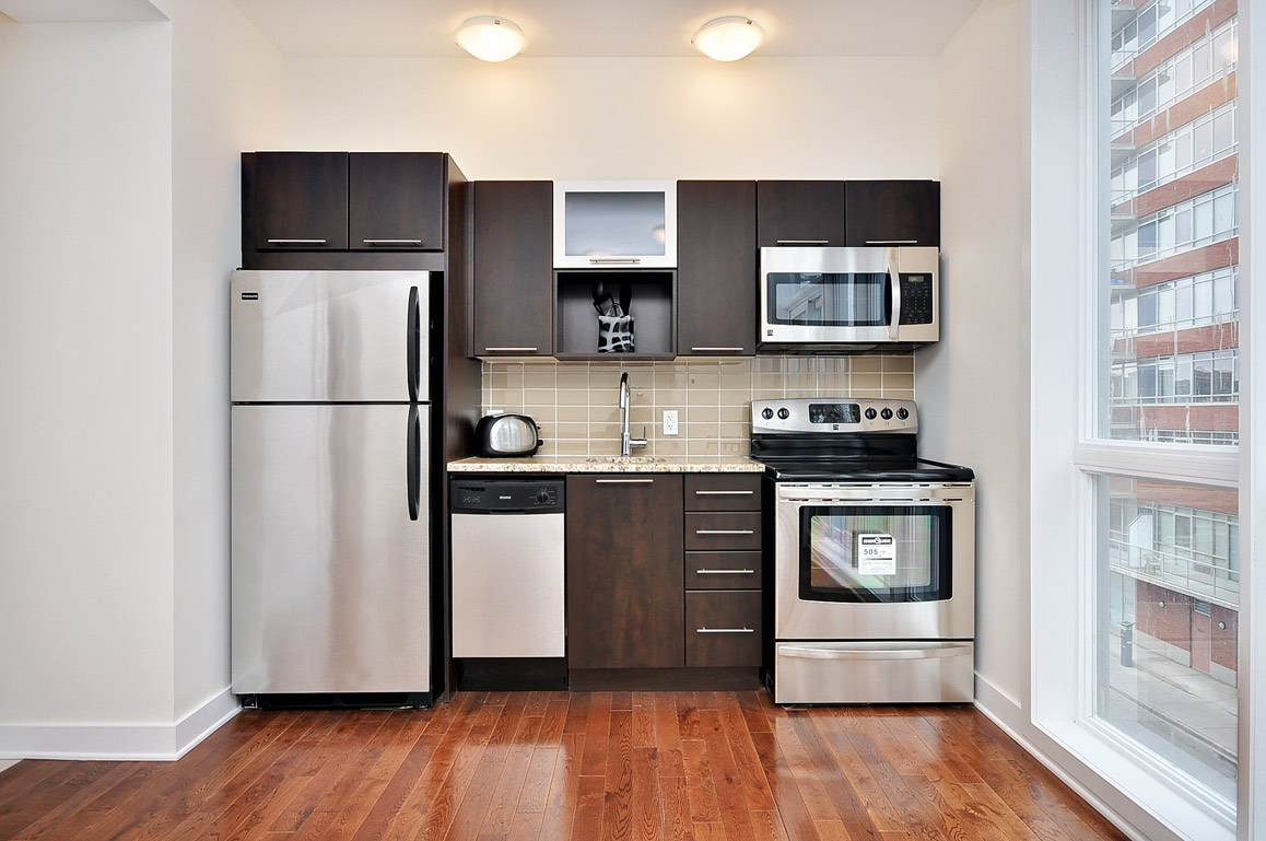 A kitchen inside a studio at 360 Lofts.