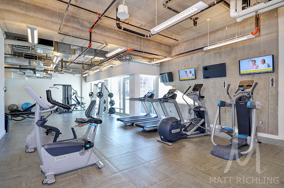 The gym at 111 Champagne (SoHo Champagne) is a common element which is paid for by the monthly condo fee.