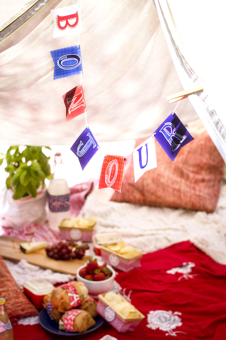 Bonjour banner flags can be hole punched and hung on string or yarn. Alternatively- tape to walls individually.