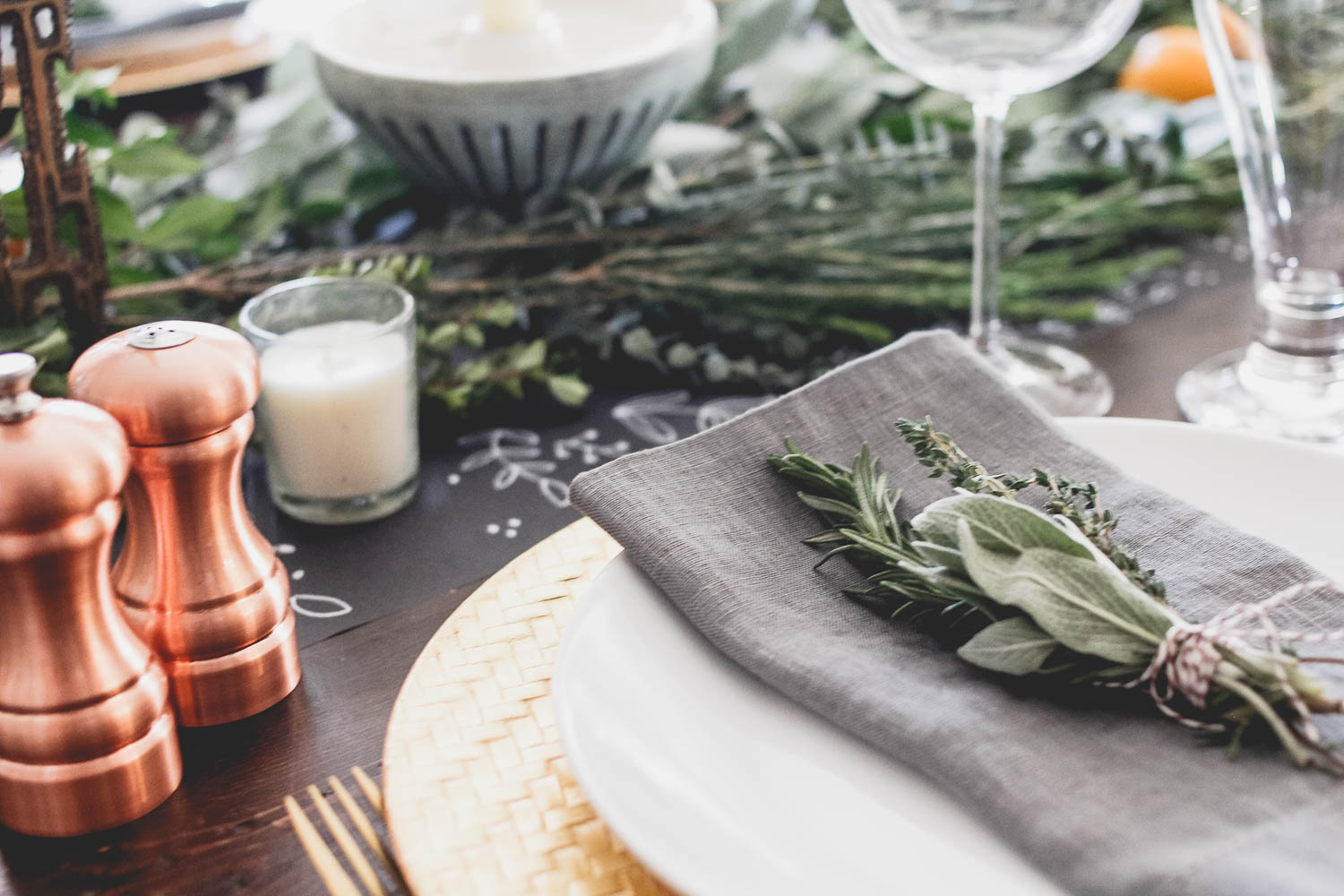 Holiday place setting with herb bouquet