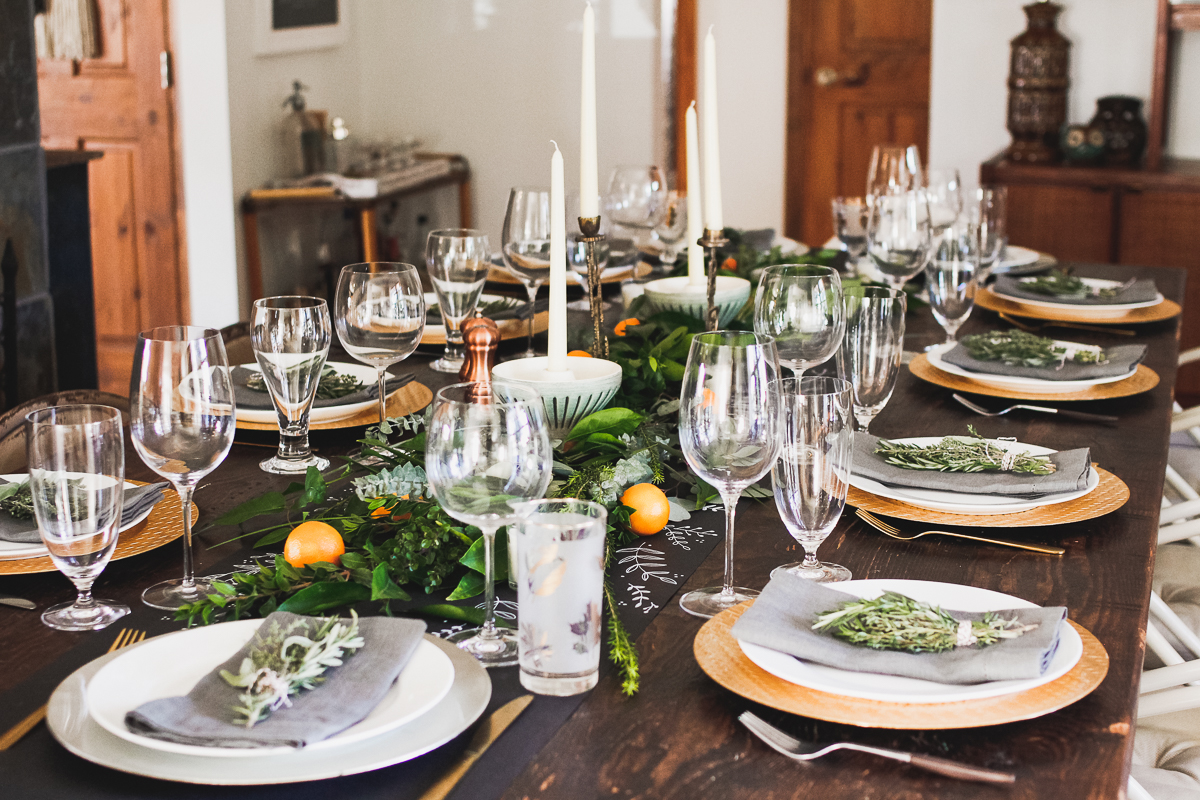 Holiday table greens eucalyptus citrus chalkboard