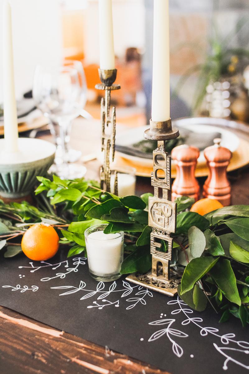 Holiday table vintage candle sticks chalkboard paper runner