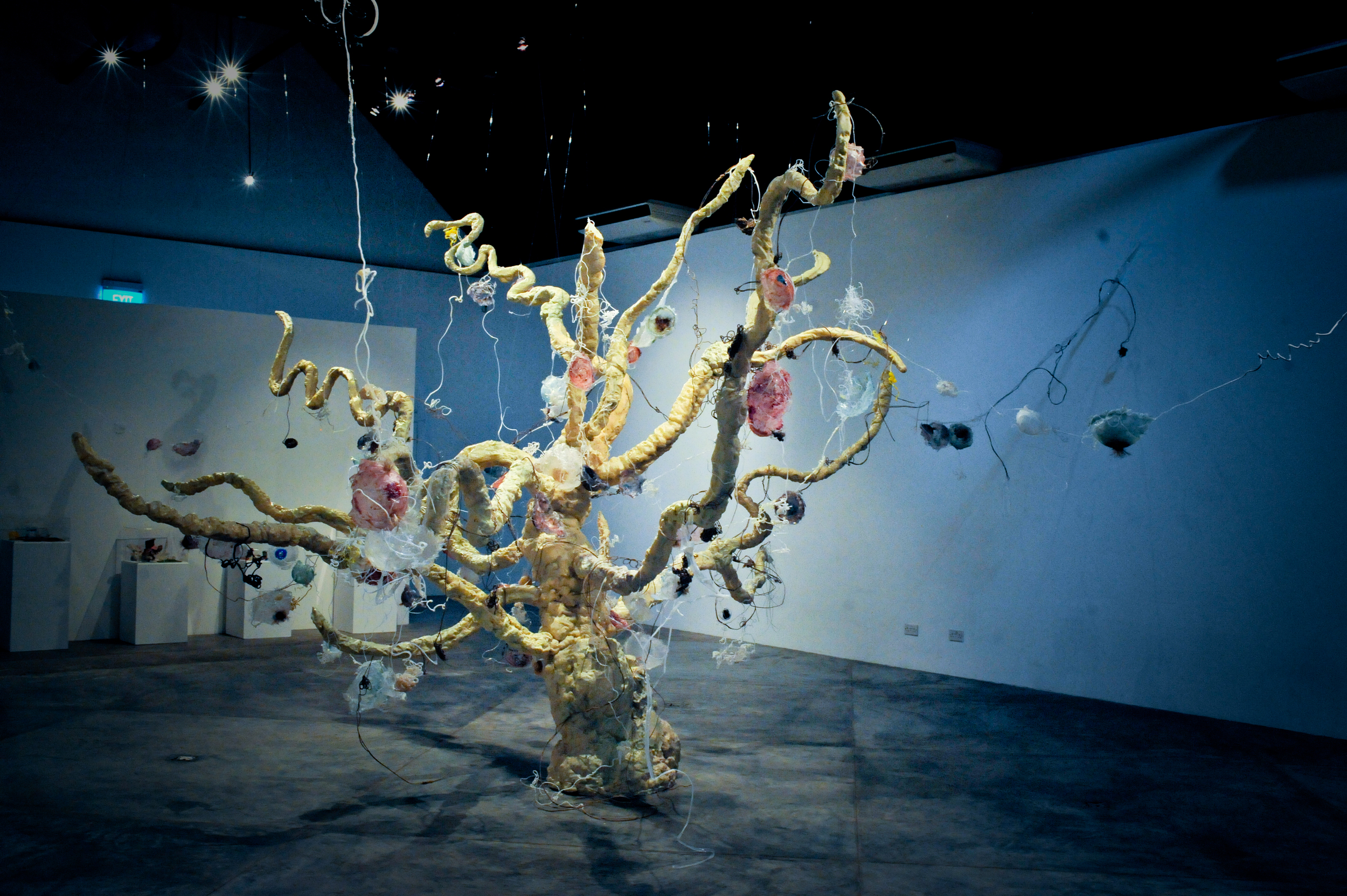 Tree of Life V , 2010  polyester resin, fiberglass, pigment, wood  variable