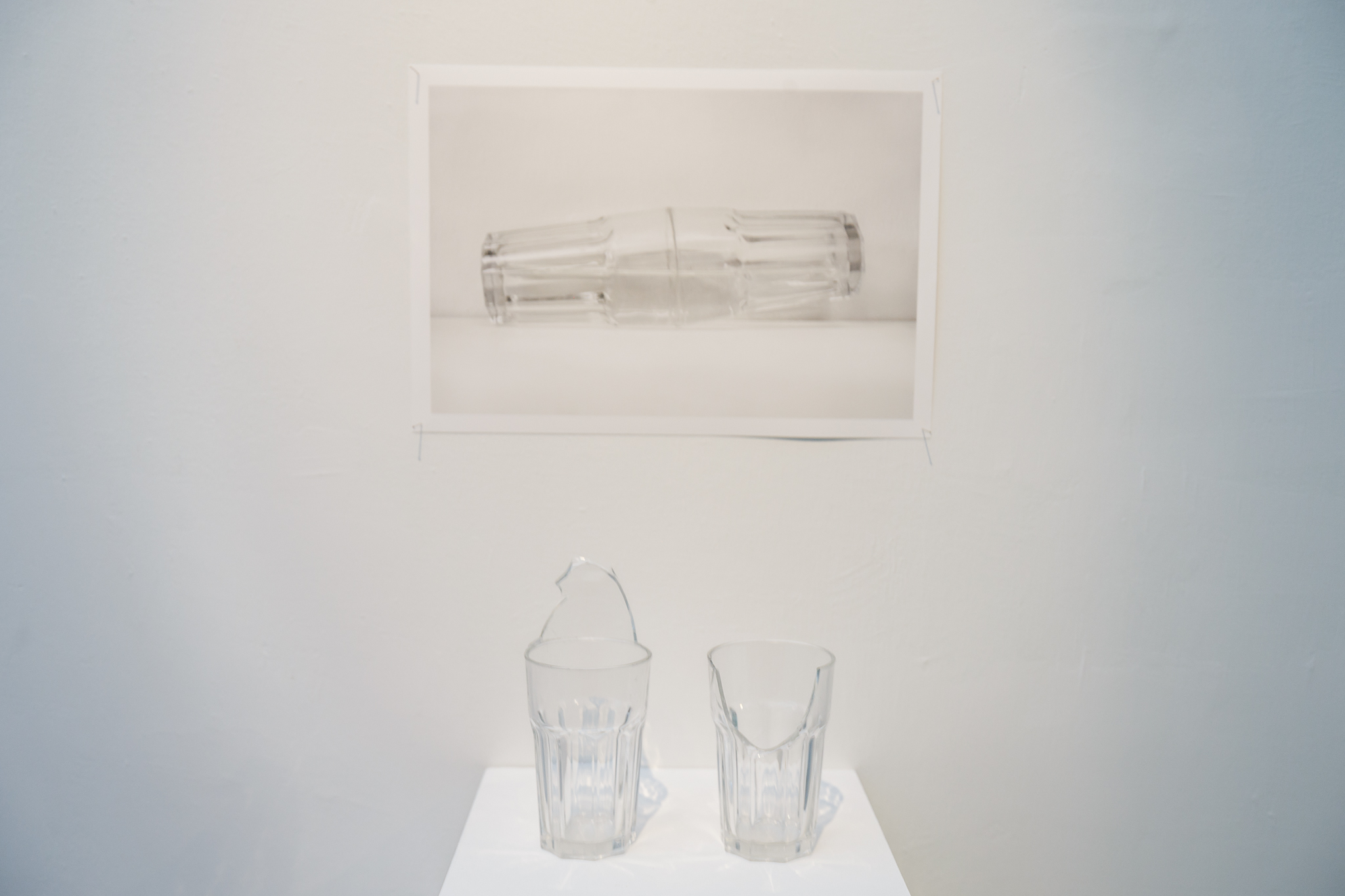Daniel Chong, A broken kiss, 2018, Broken glass cups and glue adhesive