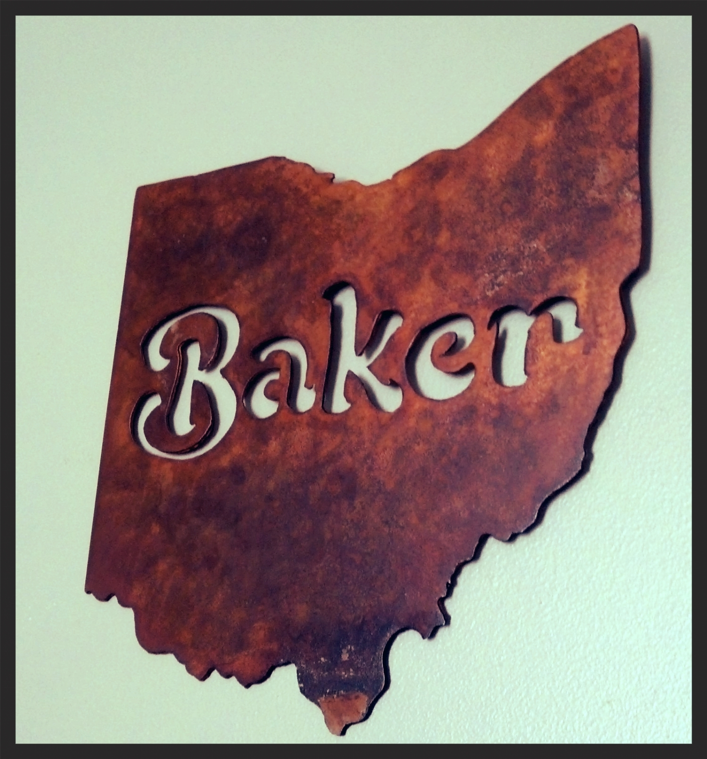 """We can create one of a kind wedding gifts for that special couple. For example, we made a 12"""" silhouette of Ohio with the last name of the newlywed couple in the center with a rustic finish."""