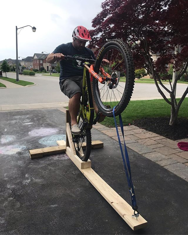 Built me a Manual Machine for Father's Day. Gifting myself some skills hopefully. 😌 Although it looks like I'm doing a wheelie on a religious symbol. 🤭 #manualmachine #gmbn #fulcrum #leverage #itsallinthehips #dads #fathersday #mtb @bringyourbike @dialed_suspension