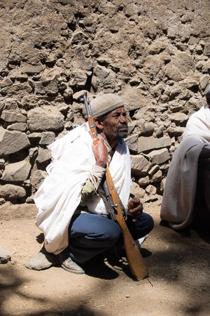 Guard at the hilltop monastery, Lalibela