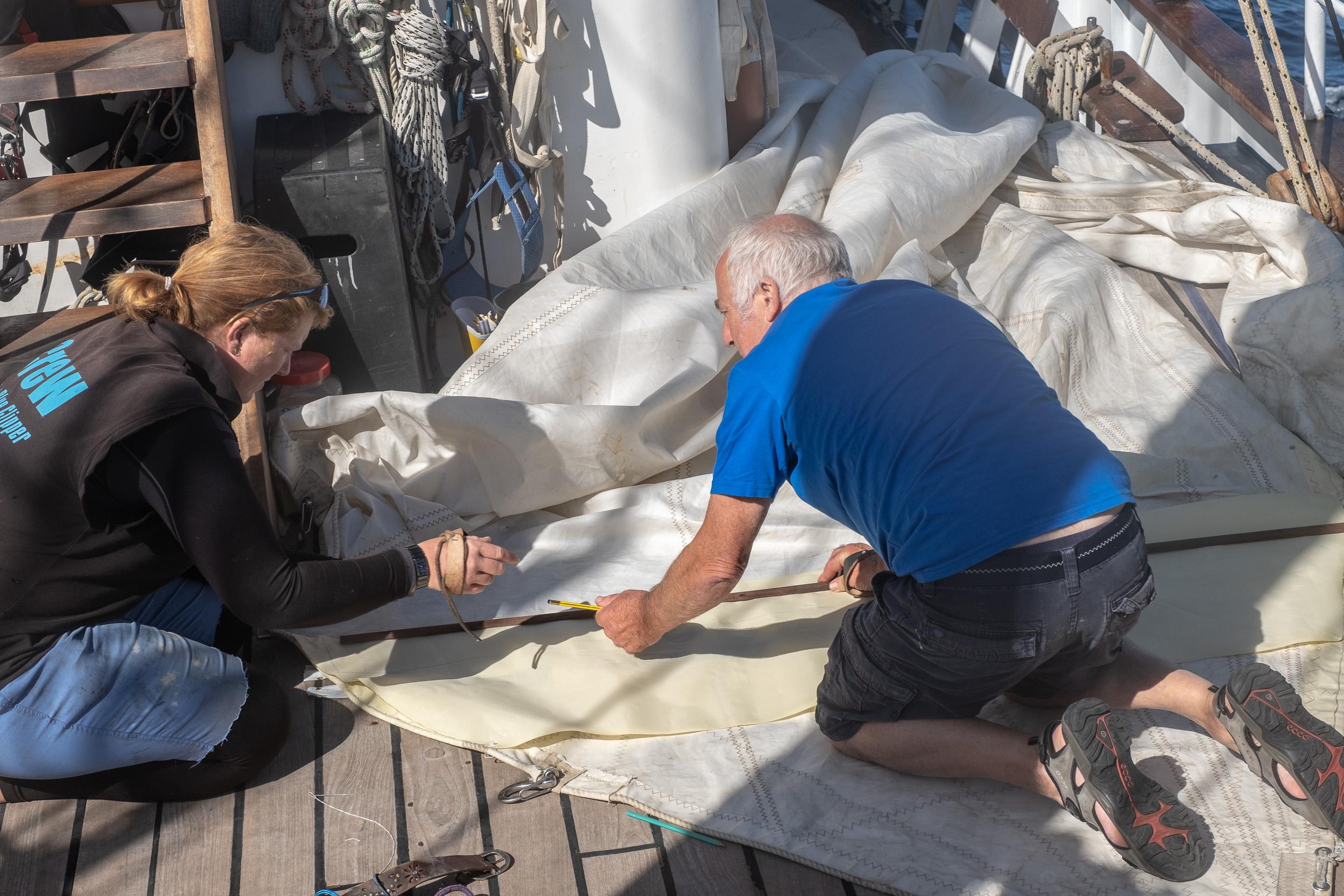 Sail repair at sea - Captain Chris & Grace