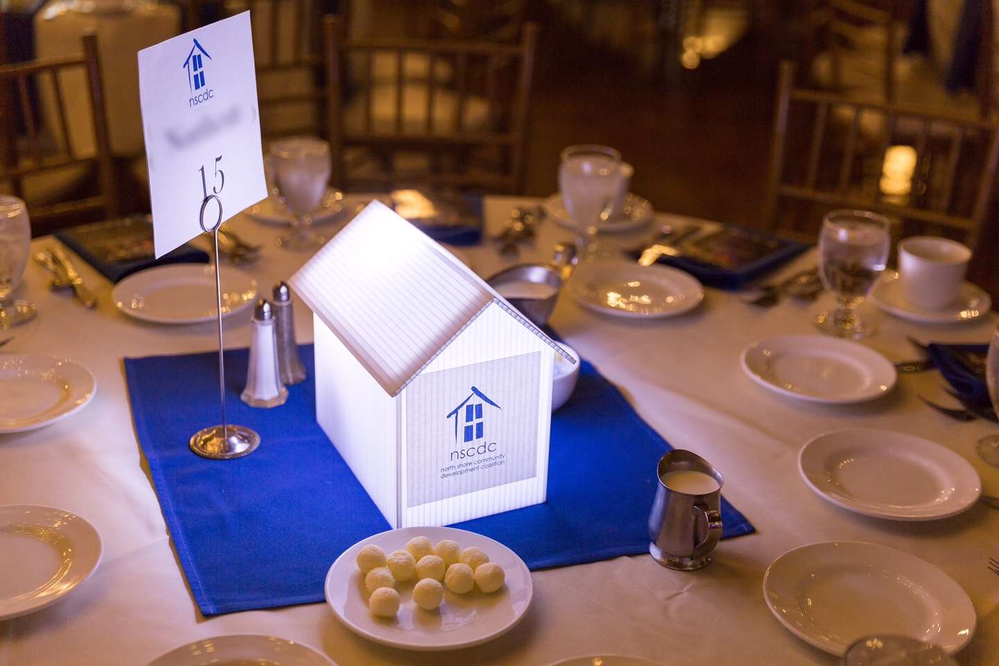 In this photo, you see a custom centerpiece that was designed for a corporate client to match their logo.